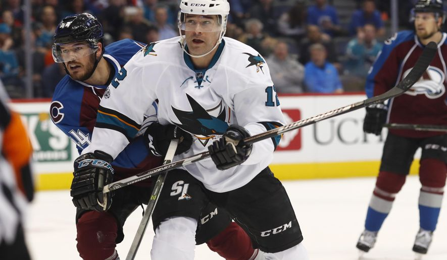 San Jose Sharks left wing Patrick Marleau, right, follows the puck as it flies toward the net as Colorado Avalanche defenseman Eric Gelinas defends in the second period of an NHL hockey game, Monday, Jan. 23, 2017, in Denver. (AP Photo/David Zalubowski)