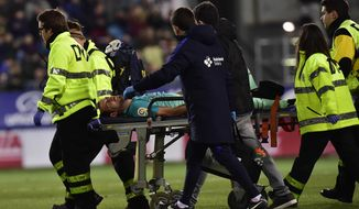 FC Barcelona's Sergio Busquets, leaves the pitch injured during the Spanish La Liga soccer match between FC Barcelona and Eibar, at Ipurua stadium in Eibar, northern Spain, Sunday, Jan. 22, 2017. (AP Photo/Alvaro Barrientos)
