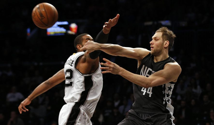Brooklyn Nets guard Bojan Bogdanovic (44) passes around San Antonio Spurs forward LaMarcus Aldridge during the first half of an NBA basketball game, Monday, Jan. 23, 2017, in New York. (AP Photo/Adam Hunger)