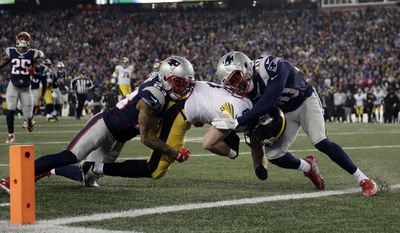 Pittsburgh Steelers tight end Jesse James is tackled short of a touchdown by New England Patriots safety Patrick Chung, left, and defensive back Duron Harmon during the first half of the AFC championship NFL football game, Sunday, Jan. 22, 2017, in Foxborough, Mass. (AP Photo/Matt Slocum)