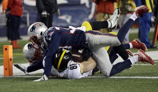 Pittsburgh Steelers tight end Jesse James (81) is tackled short of the goal line by New England Patriots safety Patrick Chung, rear, and defensive back Duron Harmon, top, during the first half of the AFC championship NFL football game, Sunday, Jan. 22, 2017, in Foxborough, Mass. (AP Photo/Elise Amendola)
