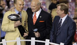 FILE- In this Feb. 6, 2011, file photo, Hall of Fame quarterback Roger Staubach, holding the Lombardi Trophy, stands by broadcast analyst Terry Bradshaw, center, and commissioner Roger Goodell, right, following the end of NFL Super Bowl XLV football game between the Pittsburgh Steelers and Green Bay Packers in Arlington, Texas. The New England Patriots earned a record ninth Super Bowl berth with a 36-17 win over the Steelers on Sunday, Jan. 22, 2017, in the AFC championship game. The Steelers, Dallas Cowboys and Denver Broncos, all with eight Super Bowl trips apiece, must wait another year before trying to join the Patriots in rarefied company.  (AP Photo/Lynne Sladky, File)