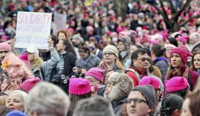 Emily Phonelath blows bubbles while in the crowd of the Women's March on Washington in Washington, D.C., on Saturday, Jan. 21, 2017. (Aileen Devlin /The Daily Press via AP)