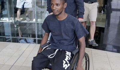 FILE - In this Aug. 10, 2016, file photo, Abdullahi Mohamed, a teenage Somali refugee who was wounded by police during a fight near a homeless shelter, leaves after his first court appearance on robbery and drug charges in Salt Lake City. Prosecutors released videos Monday, Jan. 23, 2017, of the high-profile police shooting that show an officer firing multiple times from short range at Mohamed who was wounded after refusing to drop a metal stick during the fight. (AP Photo/Rick Bowmer, File)
