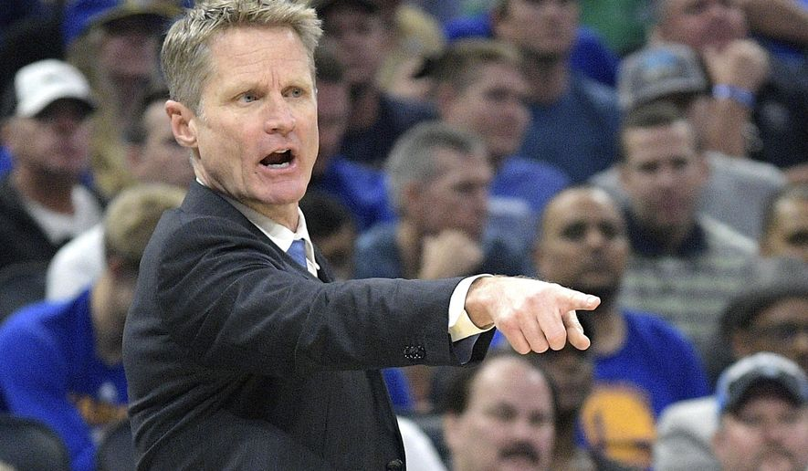 Golden State Warriors head coach Steve Kerr calls out instructions during the first half of an NBA basketball game against the Orlando Magic in Orlando, Fla., Sunday, Jan. 22, 2017. (AP Photo/Phelan M. Ebenhack)