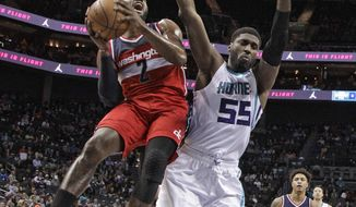 Washington Wizards' John Wall (2) drives against Charlotte Hornets' Roy Hibbert (55) in the first half of an NBA basketball game in Charlotte, N.C., Monday, Jan. 23, 2017. (AP Photo/Chuck Burton)