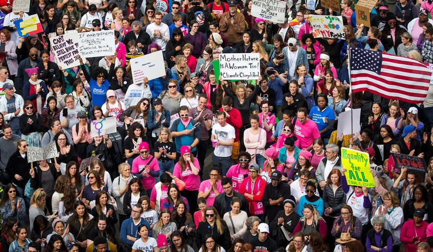 Demonstrators in Dallas and other cities around the world held events Saturday in solidarity with the Women's March on Washington, although members of some groups felt resentment and exclusion. (Associated Press)