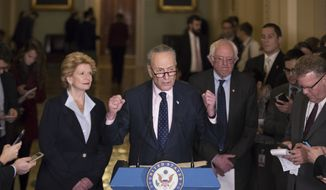 Senate Minority Leader Charles Schumer of N.Y., flanked by Sen.Debbie Stabenow, D-Mich., left, and Sen. Bernie Sanders, I-Vt., critiques policies of President Donald Trump during a news conference on Capitol Hill in Washington, Tuesday, Jan. 24, 2017. (AP Photo/J. Scott Applewhite)  ** FILE **