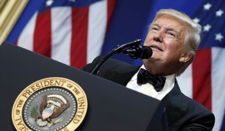 President Donald Trump speaks at The Salute To Our Armed Services Inaugural Ball in Washington, Friday, Jan. 20, 2017. (AP Photo/Alex Brandon)
