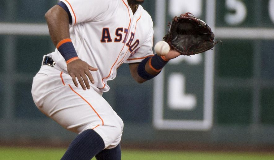 FILE - In this July 7, 2016, file photo, Houston Astros third baseman Luis Valbuena (18) fields a ball hit by the Oakland Athletics Khris Davis in the fourth inning of a baseball game in Houston. Valbuena and the Los Angeles Angels have completed a $15 million, two-year contract on Tuesday, Jan. 24, 2017. Valbuena spent the past two seasons with the Houston Astros, batting .260 last year with 13 homers and 40 RBIs despite missing the final two months of the season with a hamstring injury. (AP Photo/George Bridges, File)
