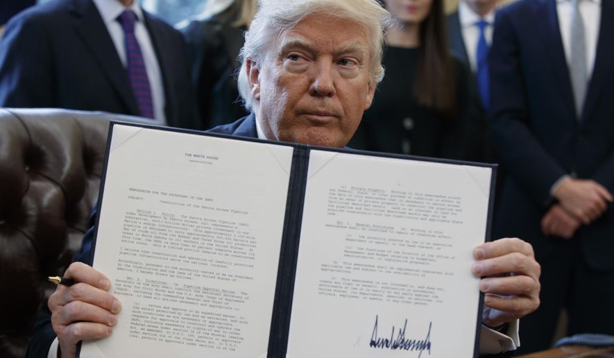 President donald trump shows off his signature on an - Define executive office of the president ...