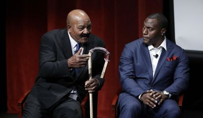 "Former NFL football players Jim Brown, left, and Takeo Spikes participate in a sports and activism panel entitled ""From Protest to Progress: Next Steps"" Tuesday, Jan. 24, 2017, in San Jose, Calif. (AP Photo/Marcio Jose Sanchez)"