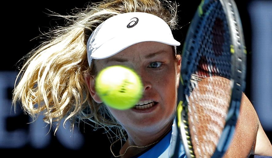 United States' Coco Vandeweghe makes a backhand return to Spain's Garbine Muguruza during their quarterfinal at the Australian Open tennis championships in Melbourne, Australia, Tuesday, Jan. 24, 2017. (AP Photo/Dita Alangkara)