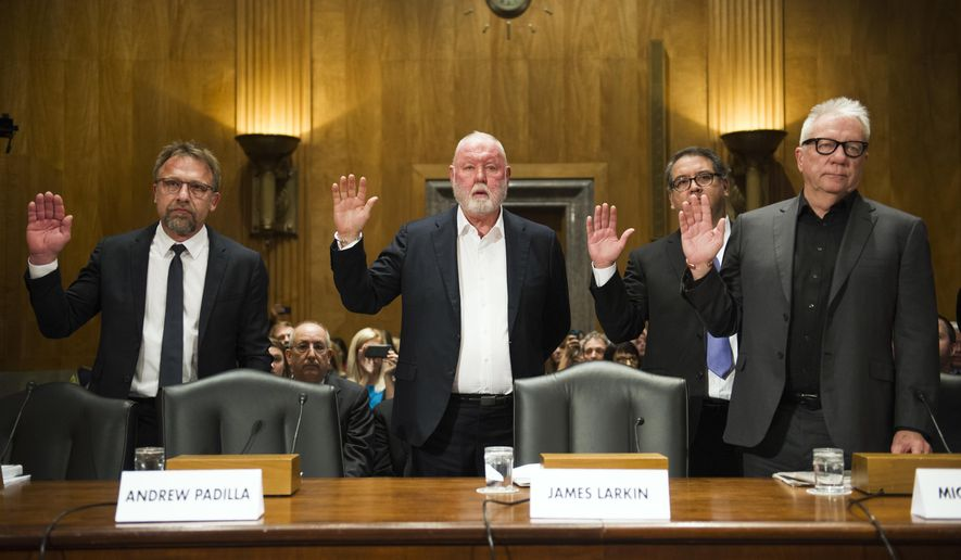 FILE - In this Jan. 10, 2017 file photo from left, Backpage.com CEO Carl Ferrer, former owner James Larkin, COO Andrew Padilla, and former owner Michael Lacey, are sworn-in on Capitol Hill in Washington, prior to testifying before the Senate Homeland Security and Governmental Affairs subcommittee hearing into Backpage.com's alleged facilitation of online sex trafficking. Ferrer, Lacy and Larkin appeared in Sacramento Superior Court Tuesday, Jan. 24 to face renewed charges that include pimping, conspiracy and money laundering. (AP Photo/Cliff Owen, File)
