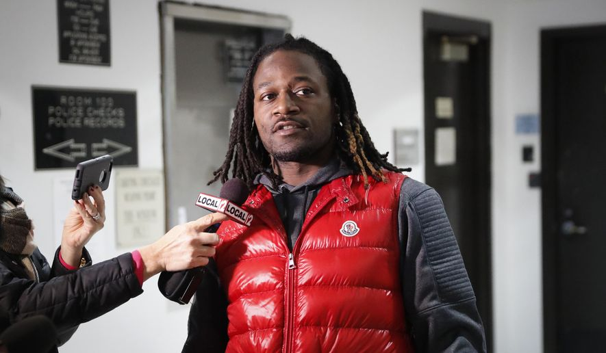 "FILE - In this Jan. 4, 2017, file photo, Cincinnati Bengals cornerback Adam ""Pacman"" Jones speaks to reporters as he is released from the Hamilton County Justice Center in Cincinnati. Jones is apologizing through his attorneys after Cincinnati police released video showing his raucous, often-vulgar reaction to his latest arrest. (AP Photo/John Minchillo, File)"