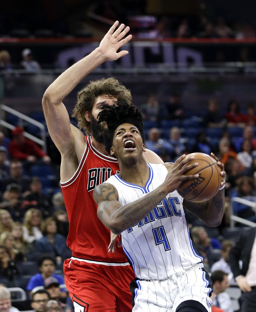 Orlando Magic's Elfrid Payton (4) goes to the basket in front of Chicago Bulls' Robin Lopez during the first half of an NBA basketball game, Tuesday, Jan. 24, 2017, in Orlando, Fla. (AP Photo/John Raoux)