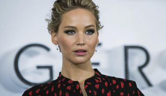 "This Dec. 1, 2016 file photo shows actress Jennifer Lawrence poses for photographers during a photo call to promote the film ""Passengers,"" in London. A federal judge in Chicago sentenced Edward Majerczyk to nine months in prison Tuesday, Jan. 24, 2017, for hacking the electronic accounts of 30 celebrities including Lawrence and stealing private information that included nude videos and photos.  (Photo by Vianney Le Caer/Invision/AP, File)"