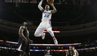 Philadelphia 76ers' Richaun Holmes (22) reacts after dunking the ball past Los Angeles Clippers' DeAndre Jordan (6) during the first half of an NBA basketball game, Tuesday, Jan. 24, 2017, in Philadelphia. (AP Photo/Matt Slocum)