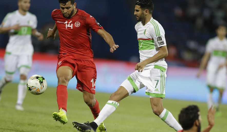Algeria's Riyad Mahrez, right, challenges Tunisia's Mohamed Amine Ben Amor, left, during the African Cup of Nations Group B soccer match between Algeria and Tunisia at Stade de Franceville Stadium in Franceville, Gabon, Thursday Jan. 19, 2017. (AP Photo/Sunday Alamba)