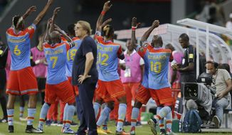 Congo players celebrate in front of Togo's Coach, Claude Le roy, centre, after the scored a goal against Togo ,during the African Cup of Nations Group C soccer match between Congo and Togo at the Stade de Port-Gentil, Gabon, Tuesday Jan. 24, 2017. (AP Photo/Sunday Alamba)