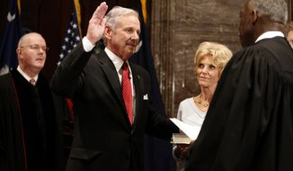 South Carolina Governor Henry McMaster, at left, is sworn in as by S.C. Chief Justice Don Beatty, at right, during a ceremonial swearing in at the Statehouse Tuesday Jan. 24, 2017, in Columbia, S.C. In middle is McMaster's wife Peggy. (AP Photo/Mic Smith)