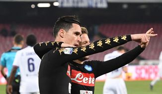 Napoli's Jose Callejon, left, celebrates with teammate Dries Mertens after scoring, during an Italian Cup, Round of 8 soccer match between Napoli and Fiorentina, at the San Paolo stadium in Naples, Italy, Tuesday, Jan. 24, 2017. (Ciro Fusco/ANSA via AP)