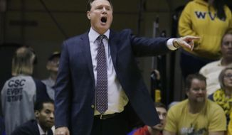 Kansas head coach Bill Self gives instructions to his players during the first half of an NCAA college basketball game against West Virginia, Tuesday, Jan. 24, 2017, in Morgantown, W.Va. (AP Photo/Raymond Thompson)