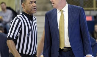 Pittsburgh head coach Kevin Stallings talks to an official after being ejected during the second half of an NCAA college basketball game against Louisville, Tuesday, Jan. 24, 2017, in Pittsburgh. (AP Photo/Fred Vuich)