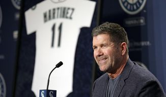 Seattle Mariners former designated hitter Edgar Martinez smiles as he speaks at a news conference announcing the retirement by the team of his jersey number 11, Tuesday, Jan. 24, 2017, in Seattle. The Mariners will retire Martinez's number as he continues to move closer to induction in the baseball Hall of Fame. Team president Kevin Mather said that Martinez's number will be officially retired Aug. 12 as part of a weekend celebration. (AP Photo/Elaine Thompson)
