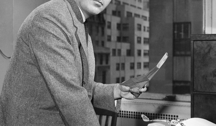 FILE - In this April 11, 1961 file photo, Associated Press business reporter John Cunniff works at his desk in New York. Cunniff, who wrote the Business Mirror column for The AP for 35 years, died Friday, Jan. 20, 2017, in Valley Cottage, New York. He was 87. (AP Photo/Ted Boyle, File)