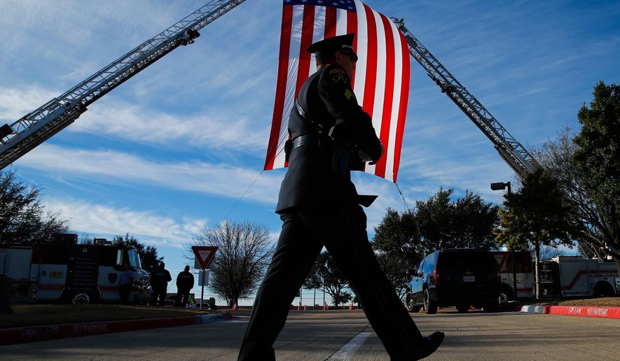 Lewisville Honor Guard Sgt. Ken Naffziger arrives for the funeral service of Little Elm police detective Jerry Walker at Prestonwood Baptist Church in Plano, Texas, Tuesday, Jan. 24, 2017. Walker, an 18-year veteran of the Little Elm department, was fatally shot Jan. 17 after responding to a report of a man outside a home armed with a long gun. (Tom Fox/The Dallas Morning News via AP)