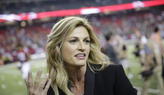 FILE - In this Oct. 30, 2016, file photo, Fox Sports broadcaster Erin Andrews, left, speaks with Atlanta Falcons wide receiver Julio Jones after the second of an NFL football game against the Green Bay Packers in Atlanta. The Atlanta Falcons won 33-32. Andrews revealed in an interview with Sports Illustrated's MMQB that was published online on Jan. 24, 2017, that she battled cervical cancer during the NFL season. (AP Photo/David Goldman, File)