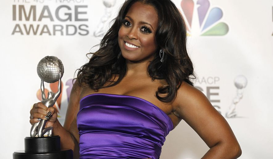 """FILE - In this Feb. 17, 2012, file photo, Keshia Knight Pulliam poses backstage with the award for outstanding supporting actress in a comedy series for """"Tyler Perry's House of Payne"""" at the 43rd NAACP Image Awards in Los Angeles. Pulliam announced the birth of daughter Ella Grace on Jan. 23, 2017. (AP Photo/Matt Sayles, File)"""