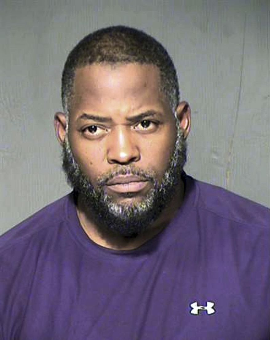 FILE - This undated file photo provided by the Maricopa County Sheriff's Department shows Abdul Malik Abdul Kareem. A jury on Thursday, March 17, 2016, convicted an Arizona man of conspiring to support Islamic State in one of the first trials in the U.S. involving charges related to the terrorist group. Abdul Malik Abdul Kareem also was found guilty on other counts stemming from an attack last spring at a Prophet Muhammad cartoon contest in Texas. Kareem was stoic when the verdict was read. (Maricopa County Sheriff's Department via AP, File)