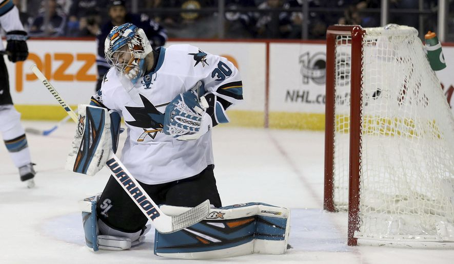 San Jose Sharks goalie gives up a goal to Winnipeg Jets center Andrew Copp during the second period of an NHL hockey game Tuesday, Jan. 24, 2017, in Winnipeg, Manitoba. (Trevor Hagan/The Canadian Press via AP)