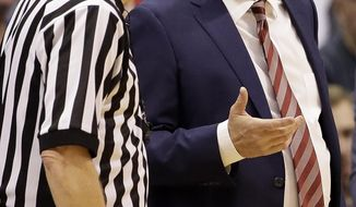 Kansas head coach Bill Self talks to an official during the first half of an NCAA college basketball game against Texas, Saturday, Jan. 21, 2017, in Lawrence, Kan. (AP Photo/Charlie Riedel)