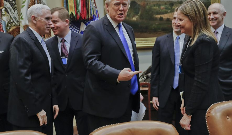 President Donald Trump gestures towards GM CEO Mary Barra, right, before the start of a meeting with automobile leaders in the Roosevelt Room of the White House in Washington, Tuesday, Jan. 24, 2017. From left are, Vice President Mike Pence, left, and Matt Blunt, president of the American Automotive Policy Council and the former governor of Missouri. (AP Photo/Pablo Martinez Monsivais)