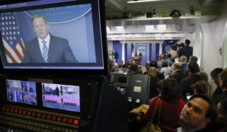 White House Press secretary Sean Spicer is seen on television broadcast monitors as he speaks to the media during the daily briefing in the Brady Press Briefing Room of the White House in Washington, Tuesday, Jan. 24, 2017. (AP Photo/Pablo Martinez Monsivais)