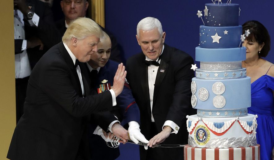 FILE - In this Jan. 20, 2017, file photo, President Donald J. Trump, left, and Vice President Mike Pence, right, are helped by Coast Guard Petty Officer 2nd Class Matthew Babot, center, as they cut a cake at The Salute To Our Armed Services Inaugural Ball Friday, Jan. 20, 2017, in Washington. Baltimore pastry chef Duff Goldman pointed out on Saturday, Jan. 21, 2017, that the cake was an exact copy of one he made for former President Barack Obama's second inaugural in 2013. A Washington pastry chef told The Washington Post she made the cake for Trump and that a client had asked for Obama's cake to be copied.  (AP Photo/David J. Phillip, File)