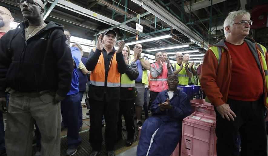 FILE - In this Tuesday, Jan. 3, 2017, file photo, Flat Rock Assembly employees clap as Ford President and CEO Mark Fields addresses the auto plant in Flat Rock, Mich. The threat from President Donald Trump to tax Mexican-made cars sold in the U.S. would throw the industry into disarray, analysts say. In early January, Ford made the surprise announcement that it would halt construction of a $1.6 billion plant in Mexico slated to build the compact Focus. It also announced plans to invest $700 million of that savings into a Michigan plant where it will make new electric and autonomous cars. (AP Photo/Carlos Osorio, File)