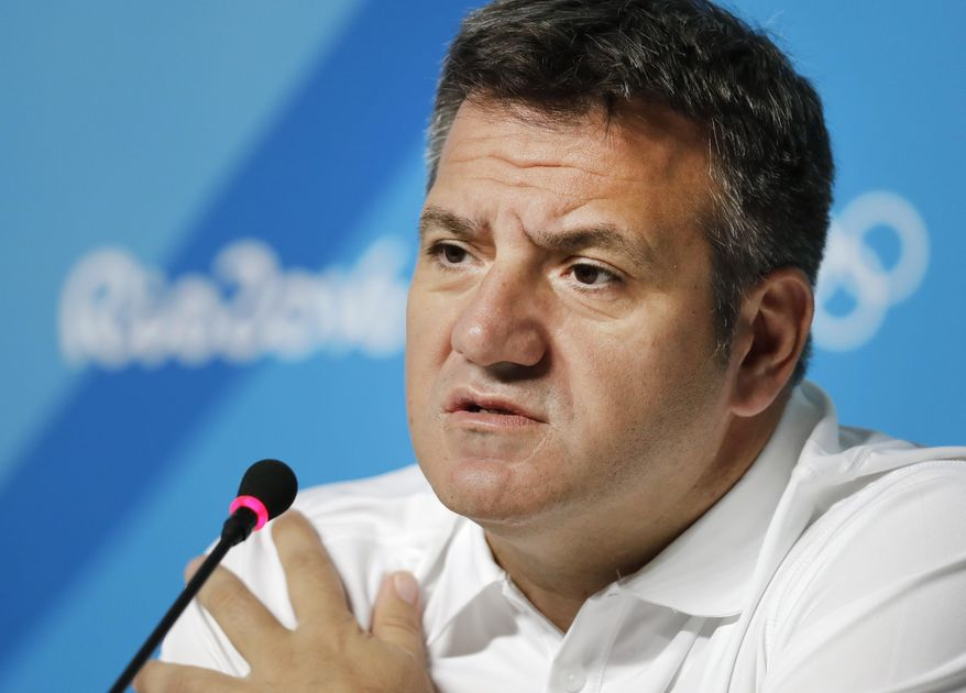 FILE - In this Aug. 5, 2016, file photo, United States' men's water polo coach Dejan Udovicic speaks during a news conference ahead of the 2016 Summer Olympics in Rio de Janeiro, Brazil. U.S. water polo coaches Adam Krikorian and Dejan Udovicic are staying on for the 2020 Tokyo Olympics. (AP Photo/Sergei Grits, File)