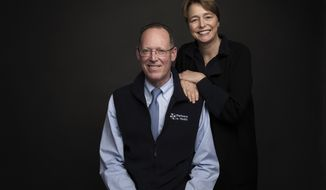 "Dr. Paul Farmer, left, and Ophelia Dahl pose for a portrait to promote the film, ""Bending the Arc"", at the Music Lodge during the Sundance Film Festival on Sunday, Jan. 22, 2017, in Park City, Utah. (Photo by Taylor Jewell/Invision/AP)"