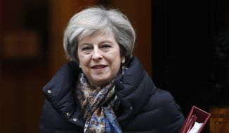 Britain's Prime Minister Theresa May leaves 10 Downing Street to attend parliament in London, Wednesday, Jan. 25, 2017. (AP Photo/Kirsty Wigglesworth)