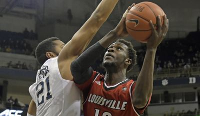 Pittsburgh forward Sheldon Jeter (21) tries to block the shot of Louisville forward Mangok Mathiang (12) during the second half of an NCAA college basketball game, Tuesday, Jan. 24, 2017, in Pittsburgh.(AP Photo/Fred Vuich) **FILE**