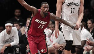 Miami Heat forward Okaro White (15) reacts as Brooklyn Nets center Brook Lopez (11) looks away after White hit a 3-point shot late in the fourth quarter of an NBA basketball game, Wednesday, Jan. 25, 2017, in New York. (AP Photo/Julie Jacobson)