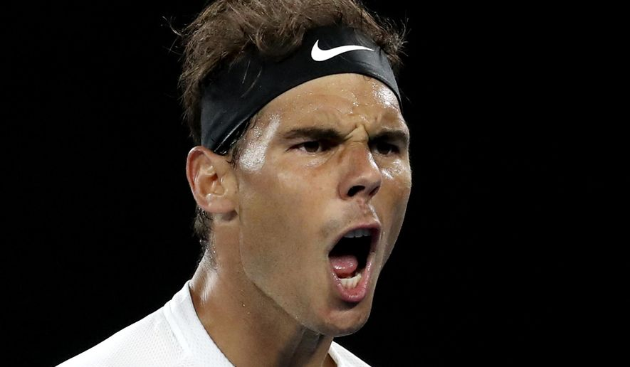 Spain's Rafael Nadal yells while playing Canada's Milos Raonic during their quarterfinal at the Australian Open tennis championships in Melbourne, Australia, Wednesday, Jan. 25, 2017. (AP Photo/Aaron Favila)