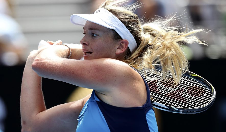 United States' Coco Vandeweghe follows through on a backhand return to compatriot Venus Williams during their semifinal at the Australian Open tennis championships in Melbourne, Australia, Thursday, Jan. 26, 2017. (AP Photo/Aaron Favila)