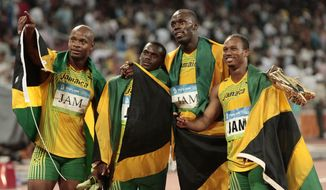In this Friday, Aug. 22, 2008, file photo, Jamaica's gold medal winning relay team, Usain Bolt, 2nd right, Michael Frater, right, Asafa Powell, left, and Nesta Carter celebrate after the men's 4x100-meter relay final during the athletics competitions in the National Stadium at the Beijing 2008 Olympics in Beijing. Usain Bolt has been stripped of one of his nine Olympic gold medals, Wednesday Jan. 25, 2017, in a doping case involving teammate Nesta Carter. (AP Photo/Itsuo Inouye, File)