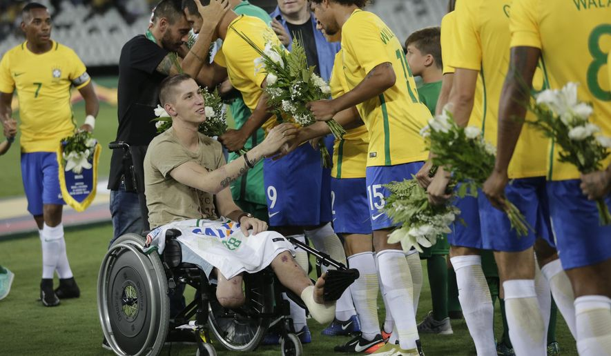 Brazil edges colombia 1 0 in charity game for chapecoense former chapecoense goalkeeper follmann in wheelchair and alan ruschel behind him greet m4hsunfo