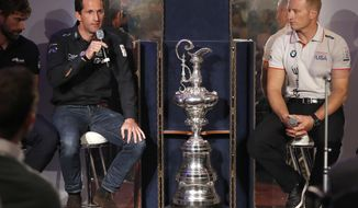 British sailor Ben Ainslie, left, speaks alongside Jimmy Spithill, skipper of Oracle Team USA during an America's Cup Press Conference in London, Wednesday, Jan. 25, 2017. (AP Photo/Kirsty Wigglesworth)
